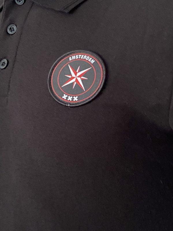 Polo Zwart Amca logo